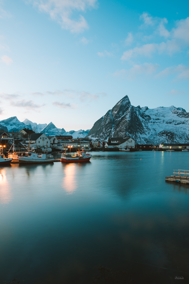 Beautiful sunset in Reine, Lofoten over the fjord