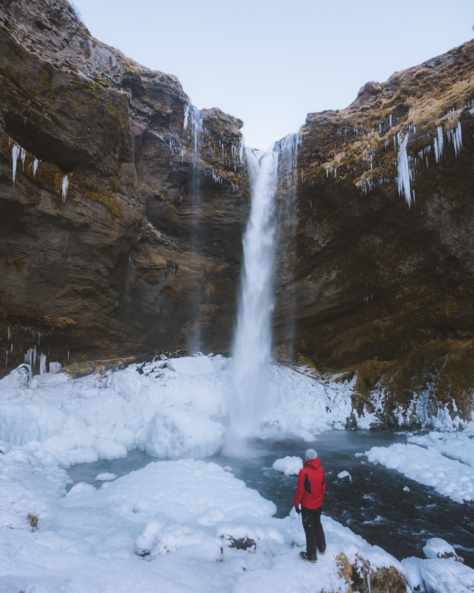 Standing in front of the Kvernufoss waterfall