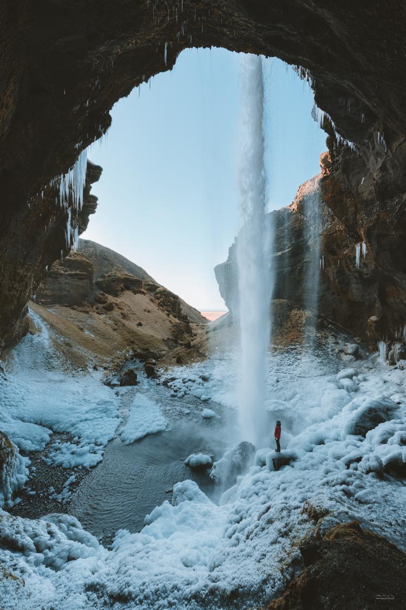 Underneath the Kvernufoss waterfall