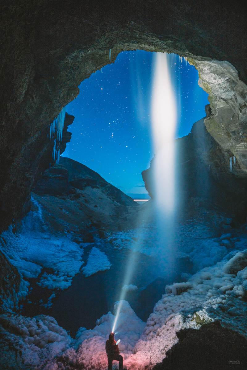 Using a head torch to light up the Kvernufoss waterfall