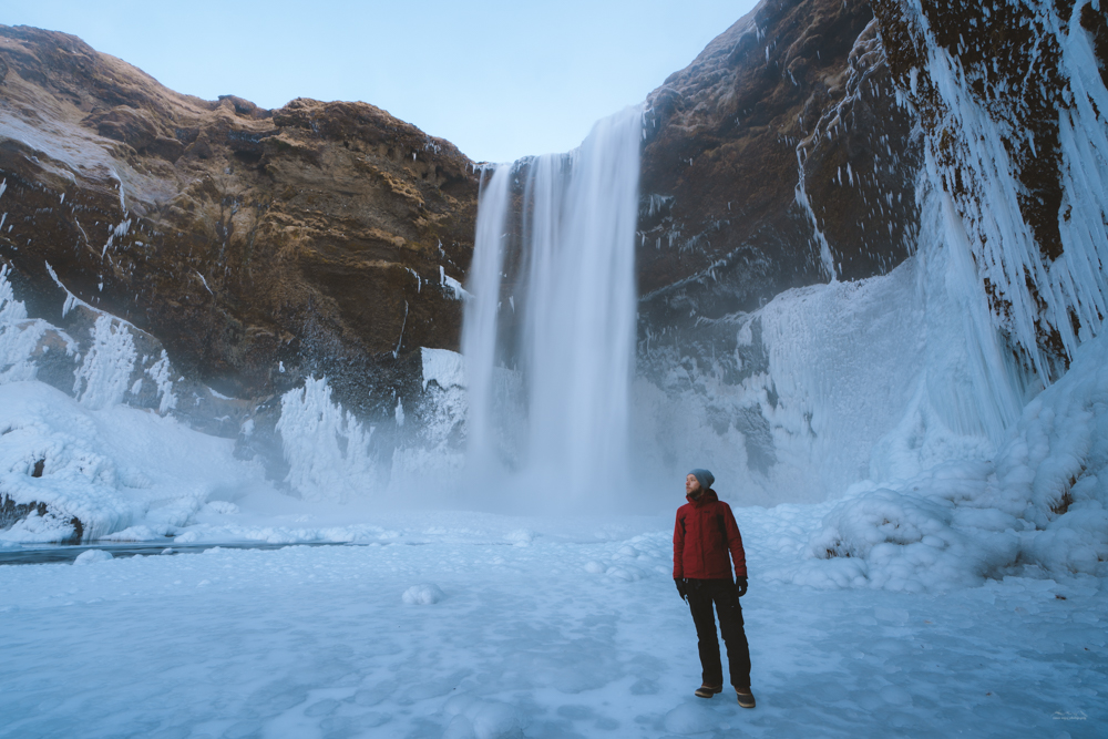 Standing in front of the Skógafoss waterfall