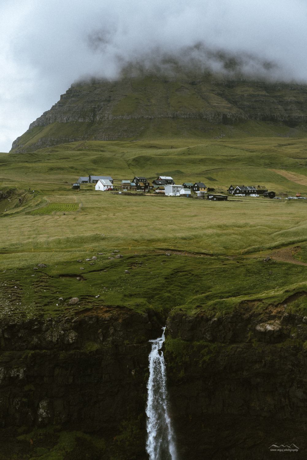View of the Múlafossur waterfall and Gasadalur village in the background