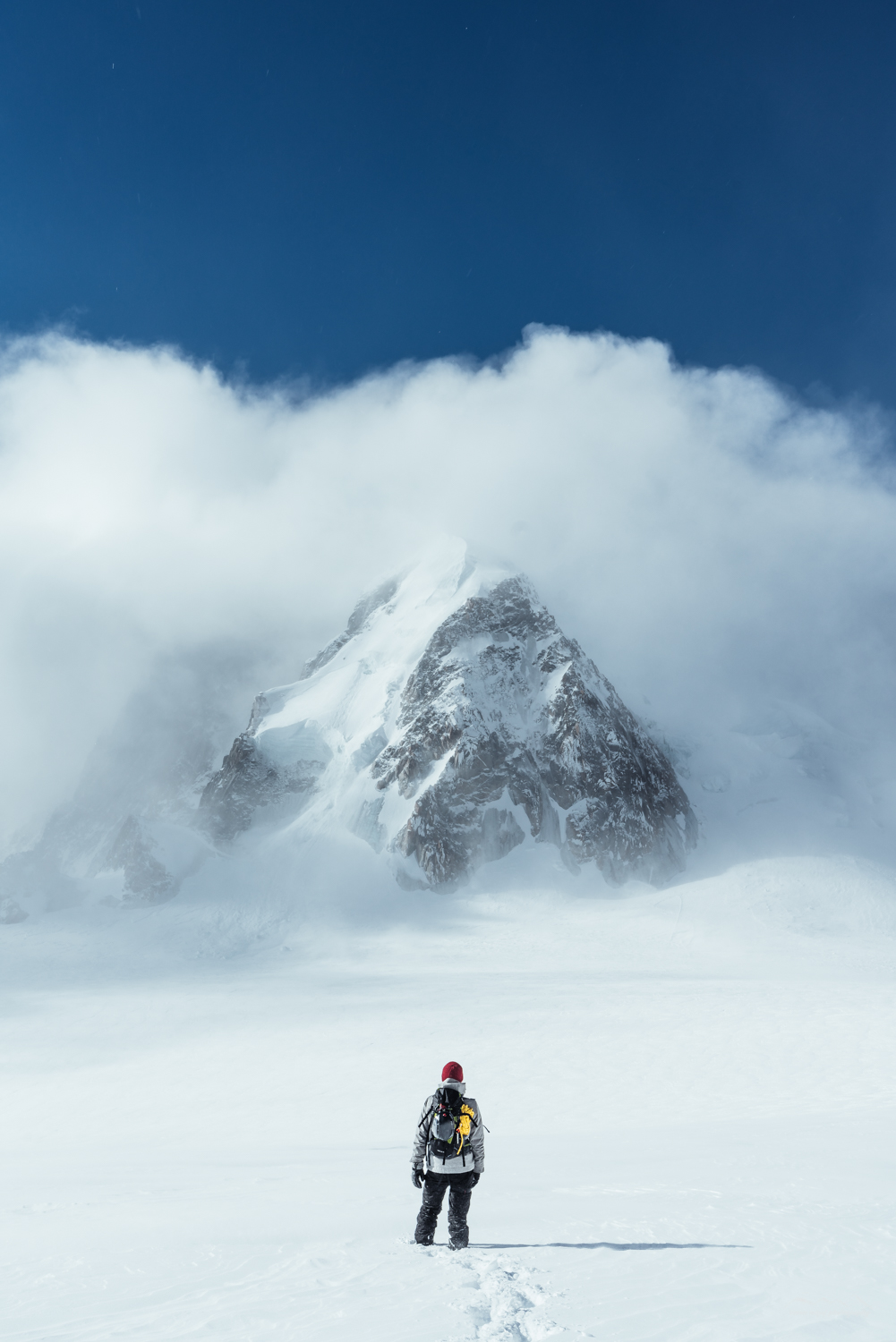Man in the snowy mountain landscape of the French Alps