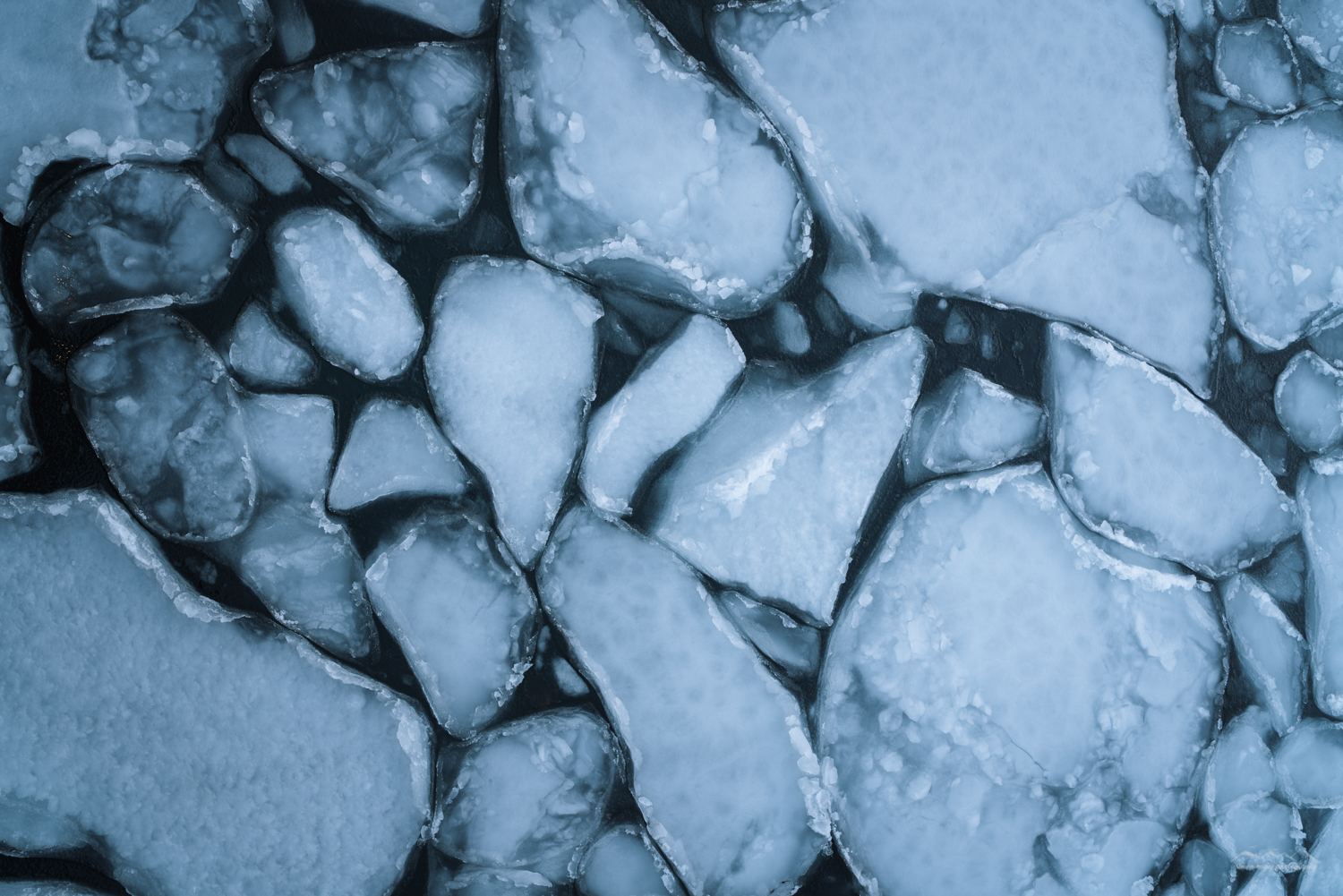 Photography of cracked ice in a fjord near Ballstad, Lofoten, Norway