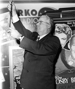 Gould reviewing an RKO film reel in 1945
