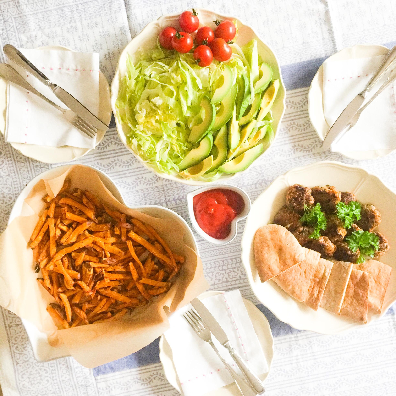 Mini Burgers, pitta pockets, homemade sweet potato chips, shredded lettuce, sliced avocado and cherry tomatoes (halve or quarter, for small children)