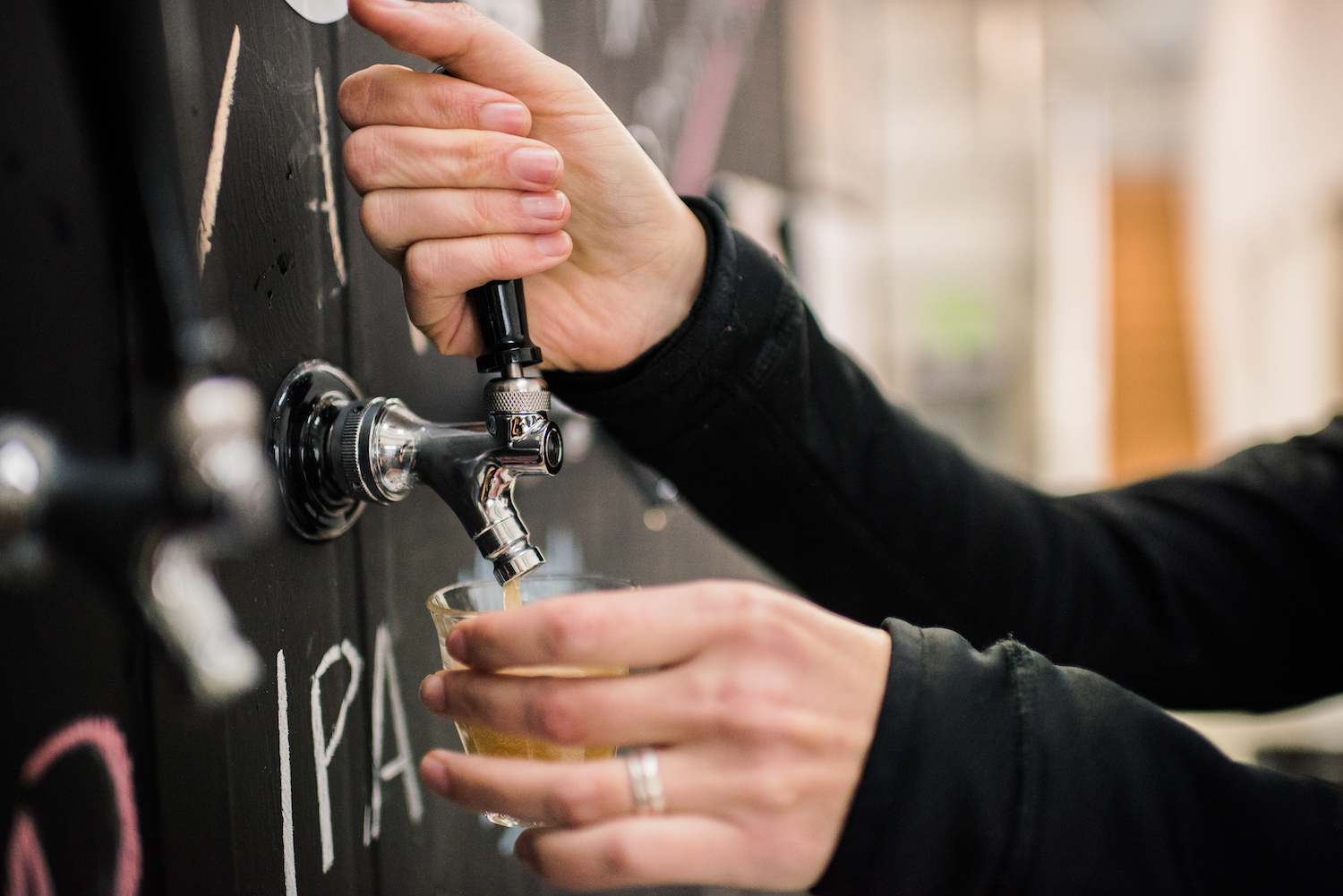 cellar door pouring beer.jpg