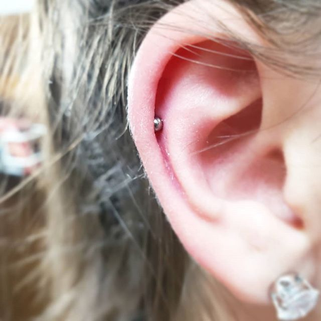 Cute little helix tucked under the wave. Thanks for stopping in on your 18th birthday Caitlin!