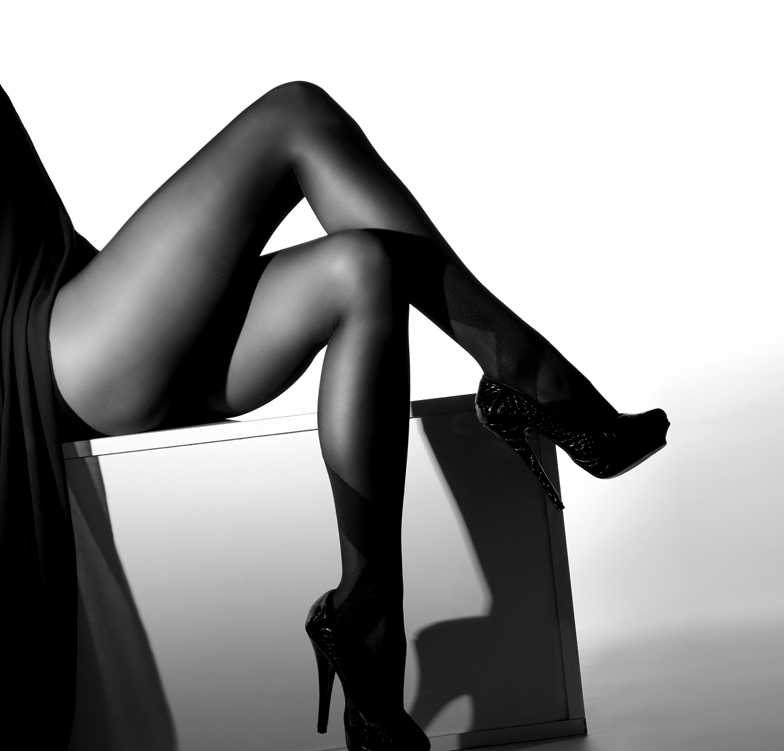 black-and-white-photo-of-legs-with-heels.jpg