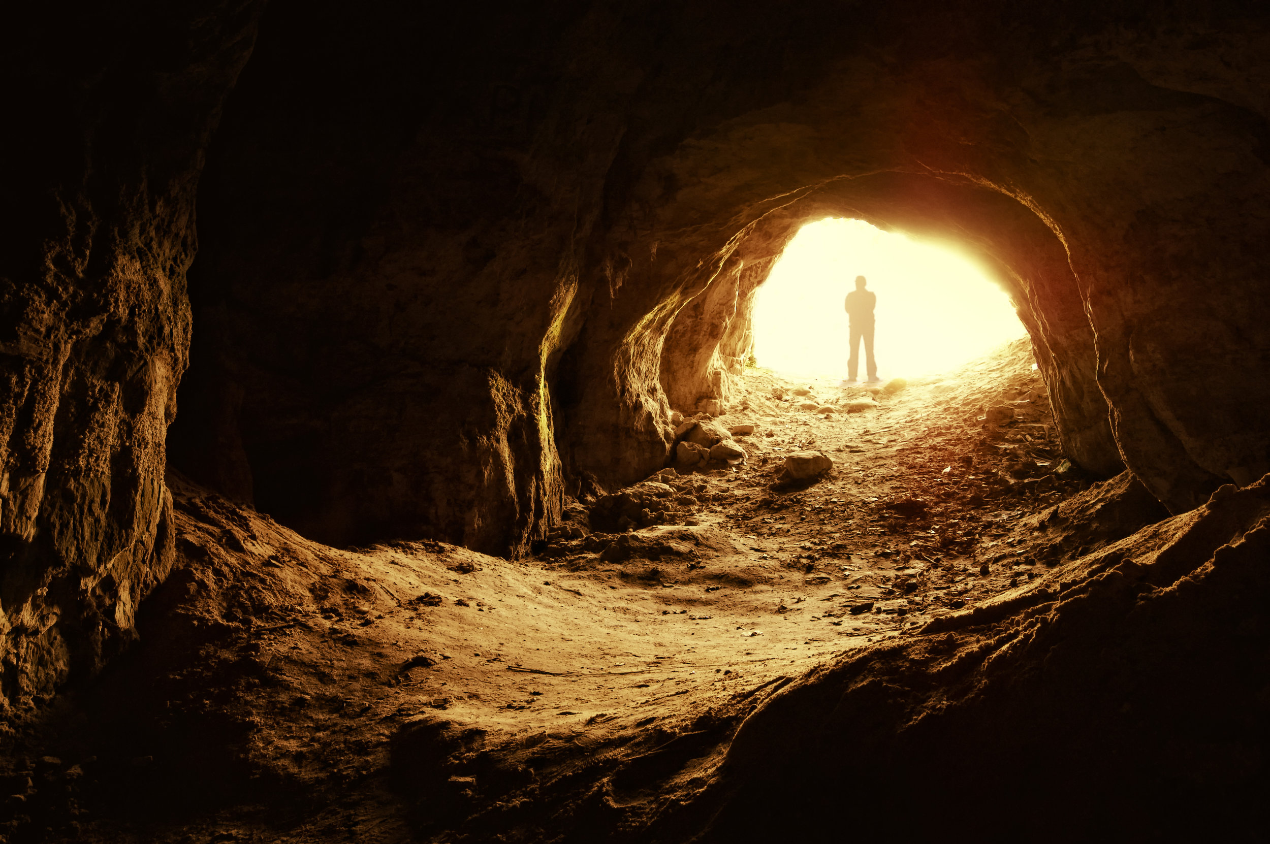 man-standing-in-front-of-cave1.jpg