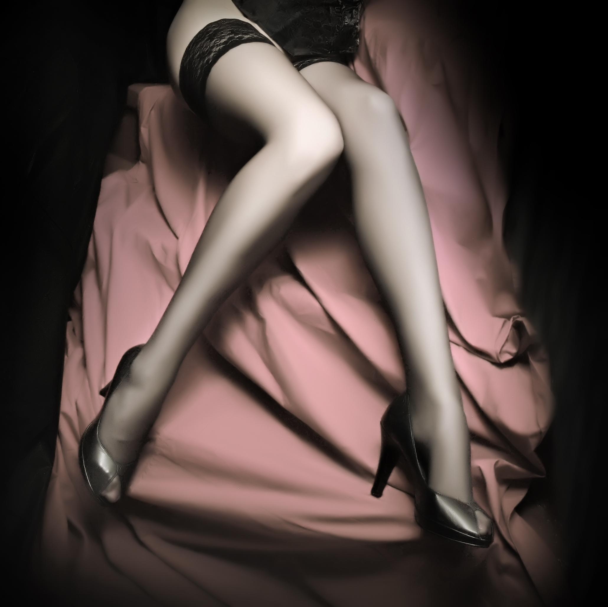 womans-legs-with-black-hose.jpg
