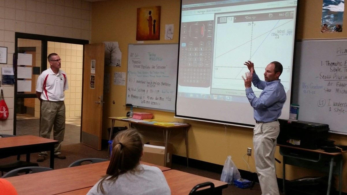 Mike Baker and Tracy Wingert sharing Texas Instrument information with pre-service teachers.