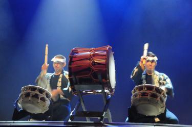 """鬼太鼓座 - Ondekoza was originally created on the Japanese island of Sado, where a group of young men and women gathered to follow the principle of """"Sogakuron""""- that """"running and drumming are one, and a reflection of the drama and energy of life"""". Living in the city of Fuji in Shizuoka, Japan, Ondekoza members live together and run together at the base of Mt. Fuji. As of 2008, Ondekoza launched a new project under the title of """"Music & Rhythms"""". The project aims to ''connect the children of world through musical experience''. Not limiting itself to taiko drums, the project uses a creative variety of expressive tools to promote the freedom of expression and the limitless possibilities it brings. Free 30-minute special lecture precedes performance @ 6:30 PM in Babka Theatre.http://ondekoza.com/aboutus.htmlTickets are sold:http://www.dbq.edu/FinePerformingArts/LiveatHeritageCenter/PerformingArtsSeries/SpecialEvents/#Ondekoza"""