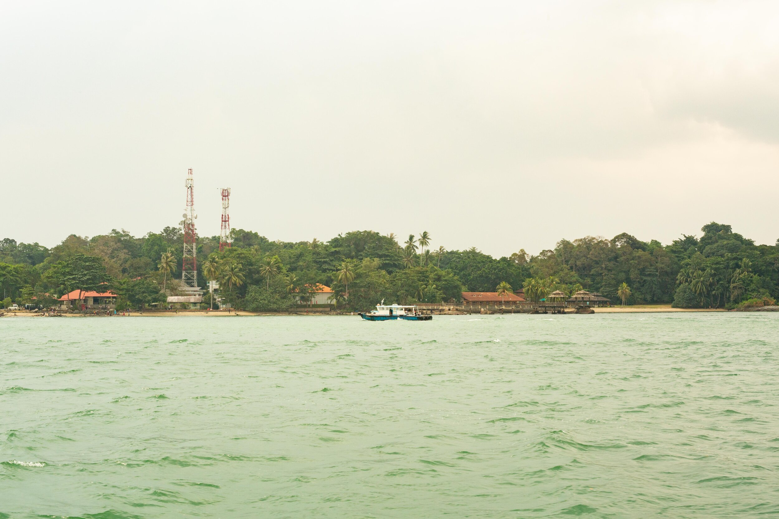 A Bumboat, with Pulau Ubin in the background