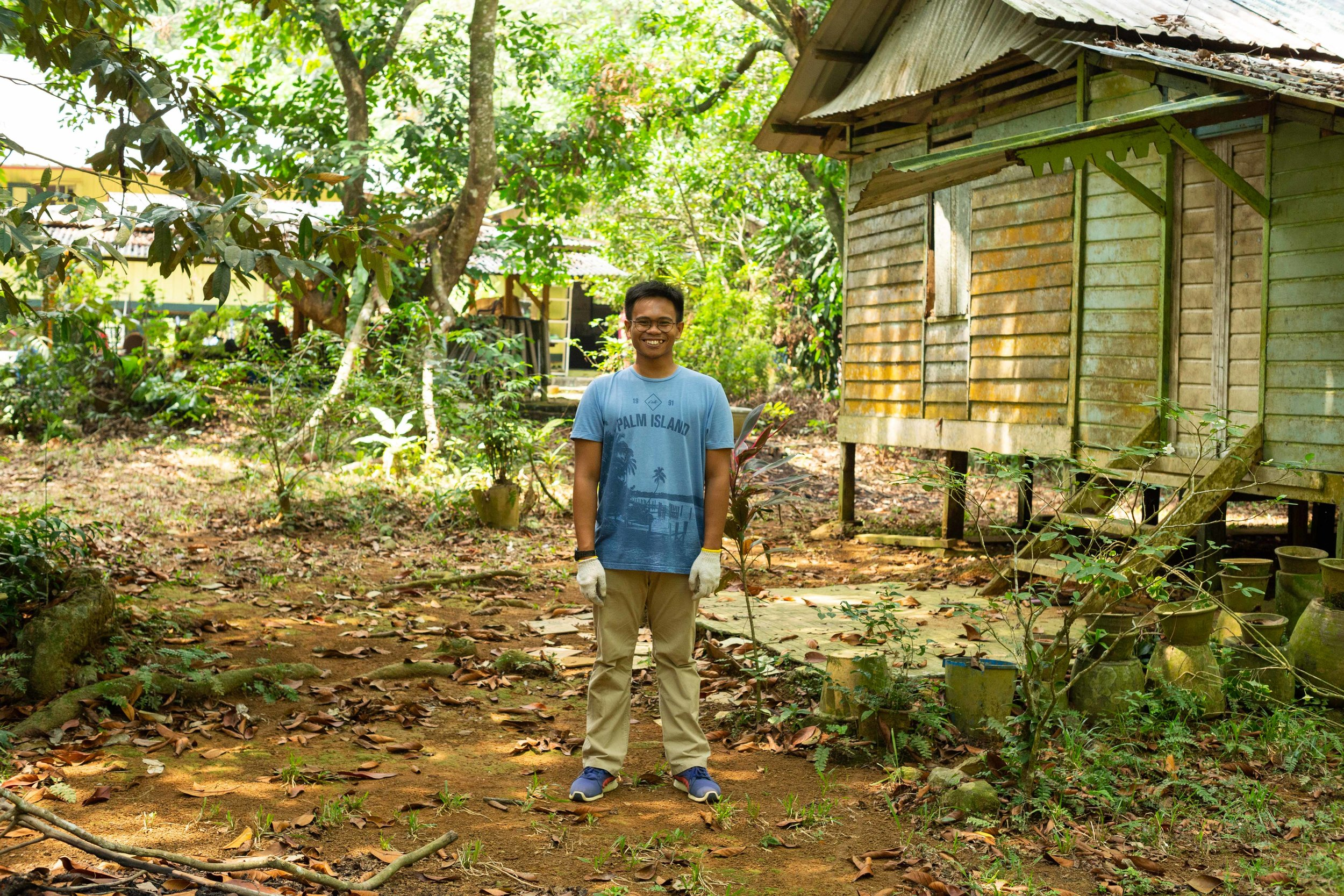 Wan standing outside a house, see image below for the 'before' image