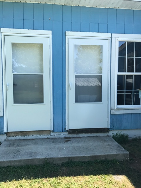 Replacement of storm doors! Job completed by John and Dale
