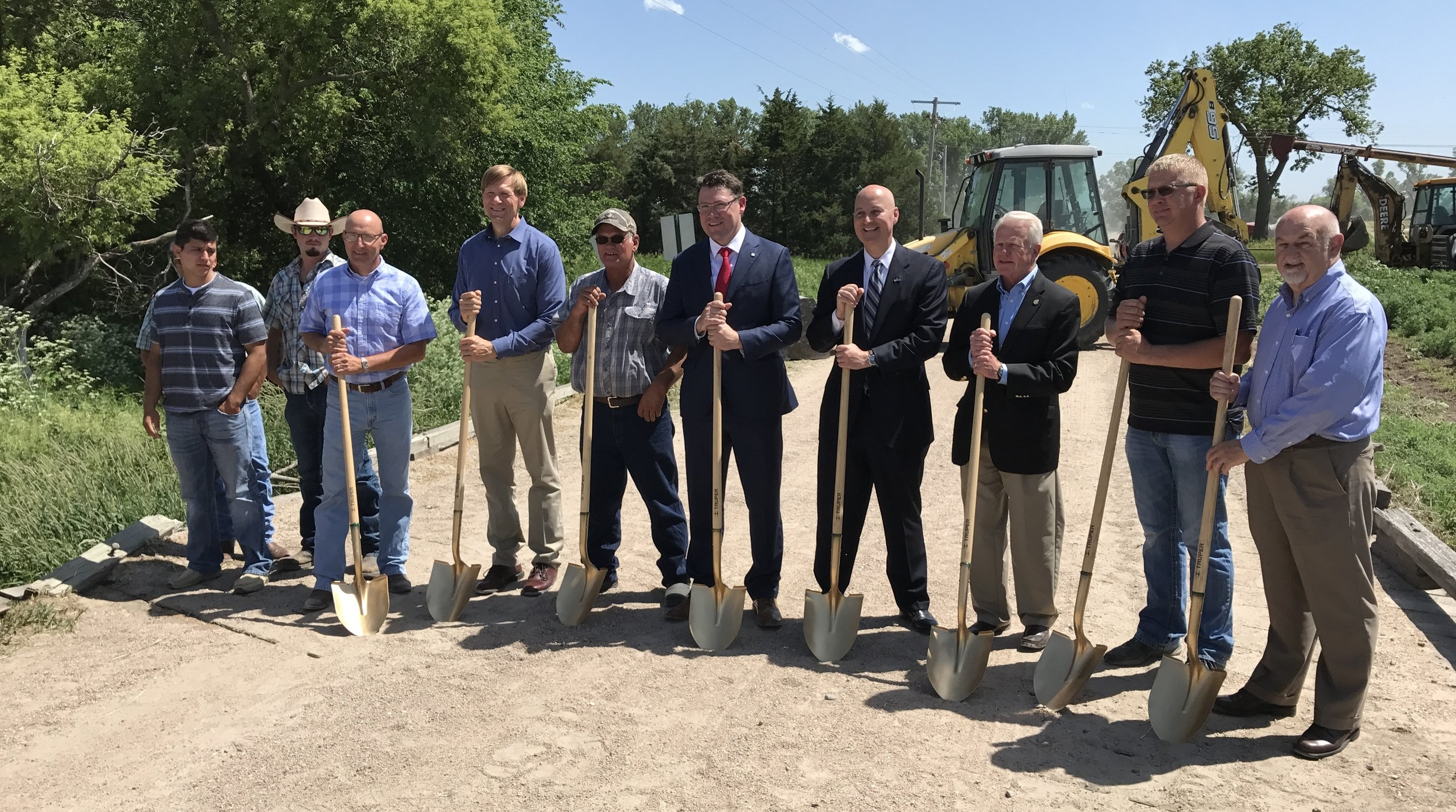 Custer County Ground Breaking Ceremony (from left - members of Custer Co Bridge Crew; Chris Jacobsen, Highway Superintendent; Mark Traynowicz, State Engineer; Larry Catlett, Bridge Foreman; Kyle Schneweis, NDOR Director; NE Governor Pete Ricketts; Senator Matt Williams; Barry Fox, Board Chairman; Larry Dix, Executive Director NACO.)