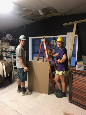 Learning how to hang drywall with our Team Leader Bolf at the youth academy.
