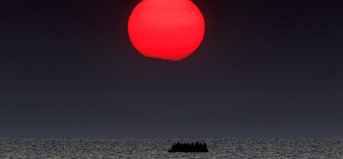 REUTERS/Yannis Behrakis. A dinghy filled with with Syrian refugees drifts in the Aegean sea between Turkey and Greece.