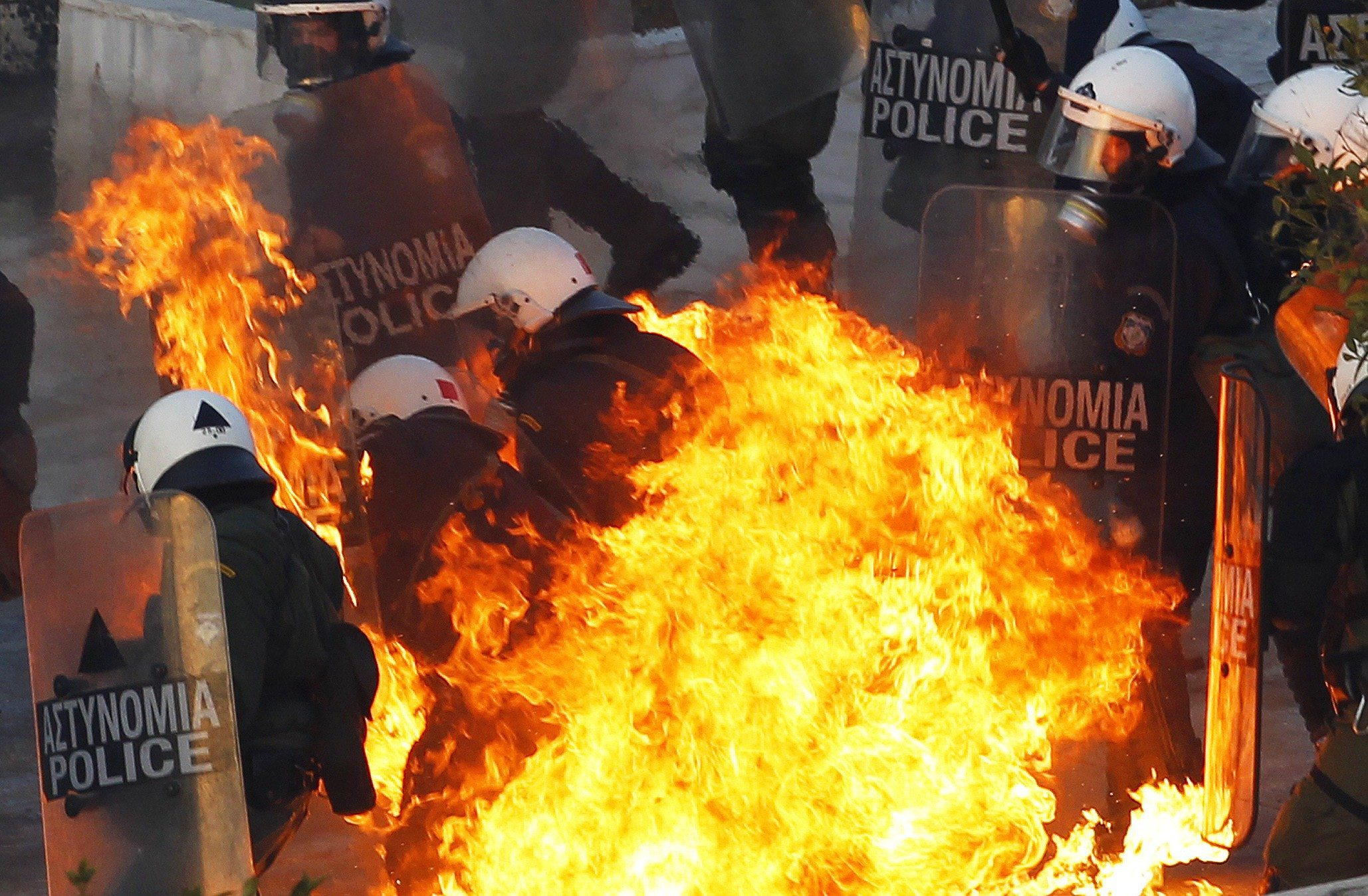 REUTERS/Yannis Behrakis. A petrol bomb explodes at riot police during an anti-austerity demonstration in Athens' Syntagma Square.