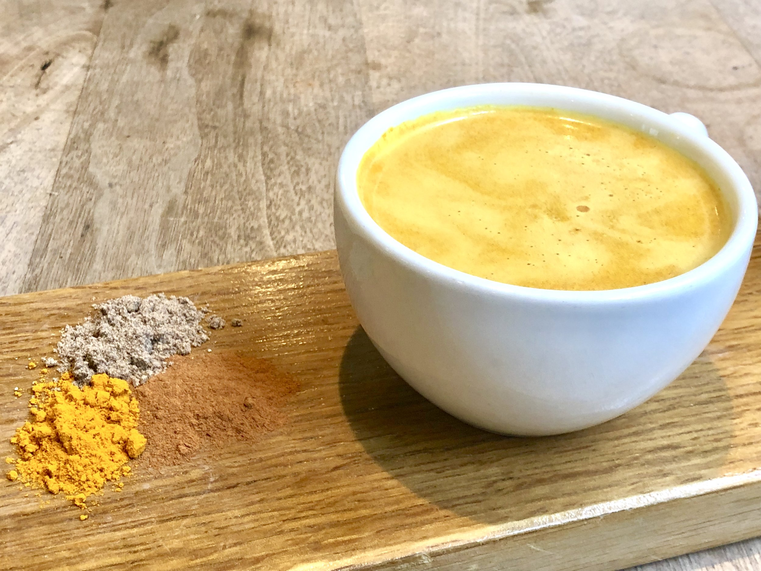 Now served at all our cafe locations…. - Our Golden Turmeric Latte is back at The Plant Cafe Organic and we couldn't be more excited! Our golden turmeric latte is a warming aromatic blend of spices - that combined together is known to have anti-inflammatory & antioxidant benefits. We blend your choice of milk with our signature turmeric spice blend and combine with a touch of agave and our homemade vanilla syrup.Looking for a caffeine boost? - Add on a shot of espresso! We use SF's local and fair trade Highwire Coffee!The Dynamic Duo that boosts this latte's health benefits:The secret to activating turmeric is black pepper. The reason is because turmeric has a compound known as Curcumin which is the bright yellow chemical that gives the vibrant color in turmeric. Curcumin is known to have wonderful anti-inflammatory properties and when you ingest turmeric with black pepper, you increase the amount of Curcumin your body can absorb and use.In our spice blend, we unite cardamom, cinnamon, turmeric, black pepper, and ginger together for a flavorful and warming latte. Try it with our signature vegan banana bread or our freshly baked seasonal fruit scones for the perfect latte and pastry combination.