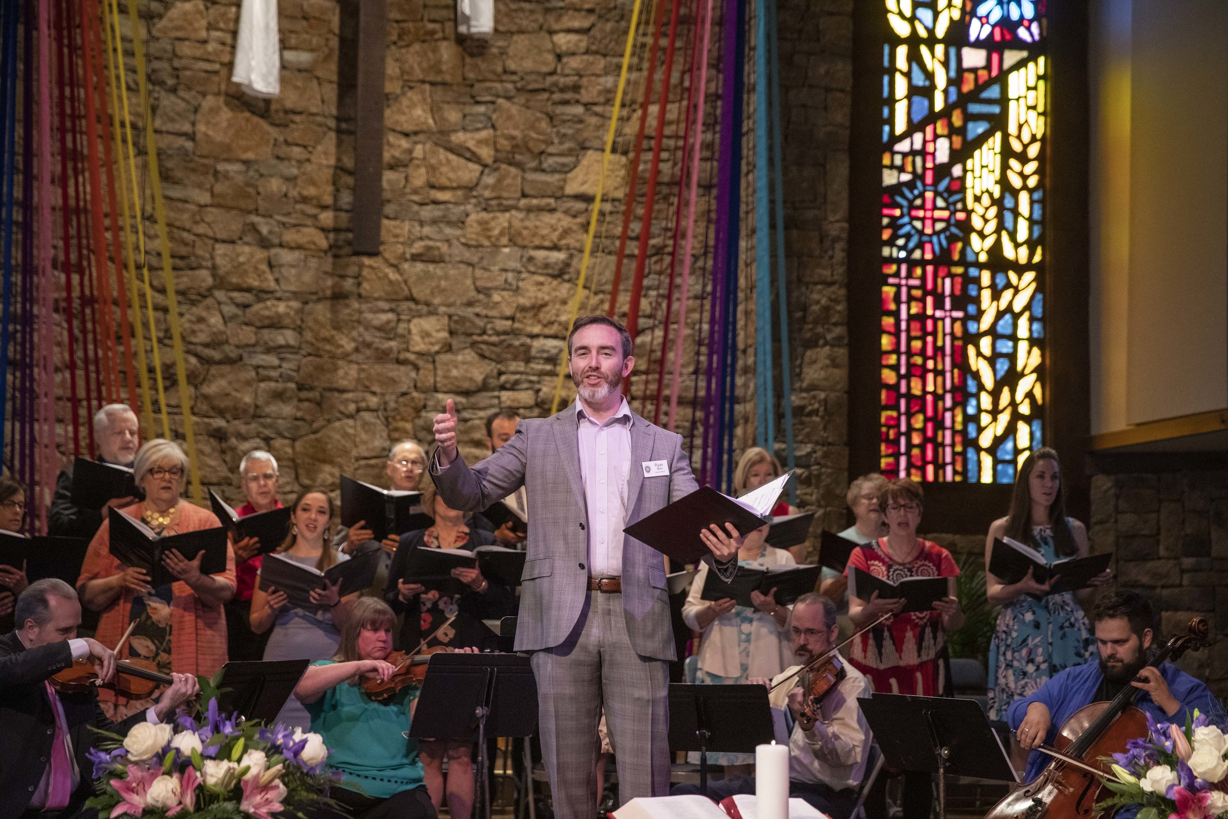 Ryan Main leads the congregation in singing - Easter 2019