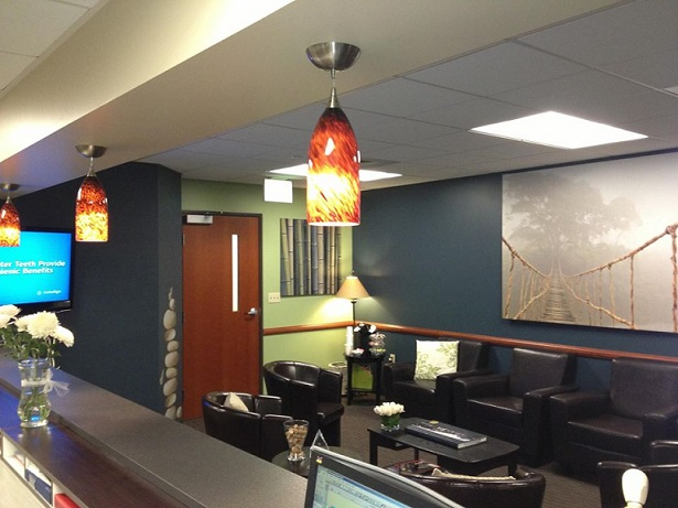 Remodeled medical reception area with pendant lighting