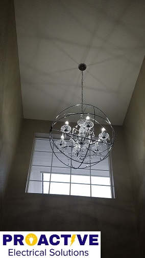 Chandelier on vaulted ceiling