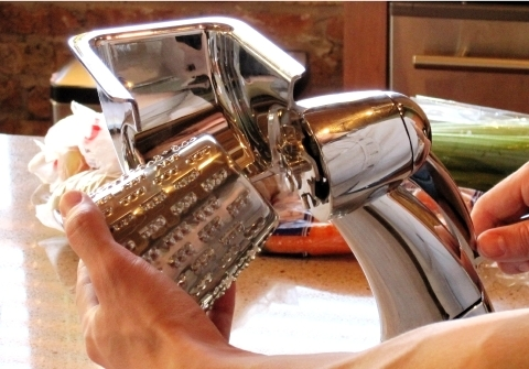 person having to remove the HyCite Food Cutter's blade by gripping the sharp outer surface