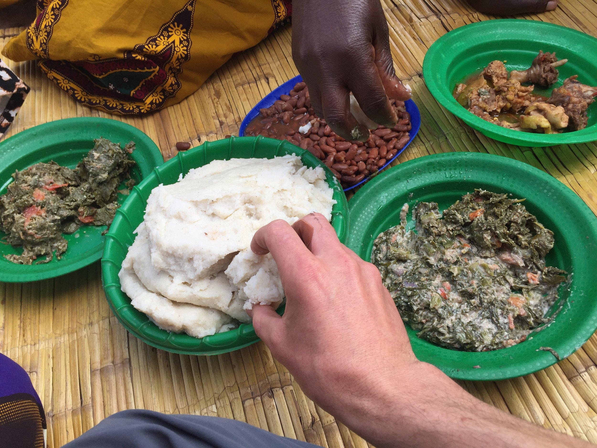 A traditional Malawian meal, eaten by hand out of shared plates. It was delicious, and the chicken in the upper right was walking around when we arrived. The lower right is  Mkhwani , the dish cooked with pumpkin leaves, peanut flour and tomatoes.