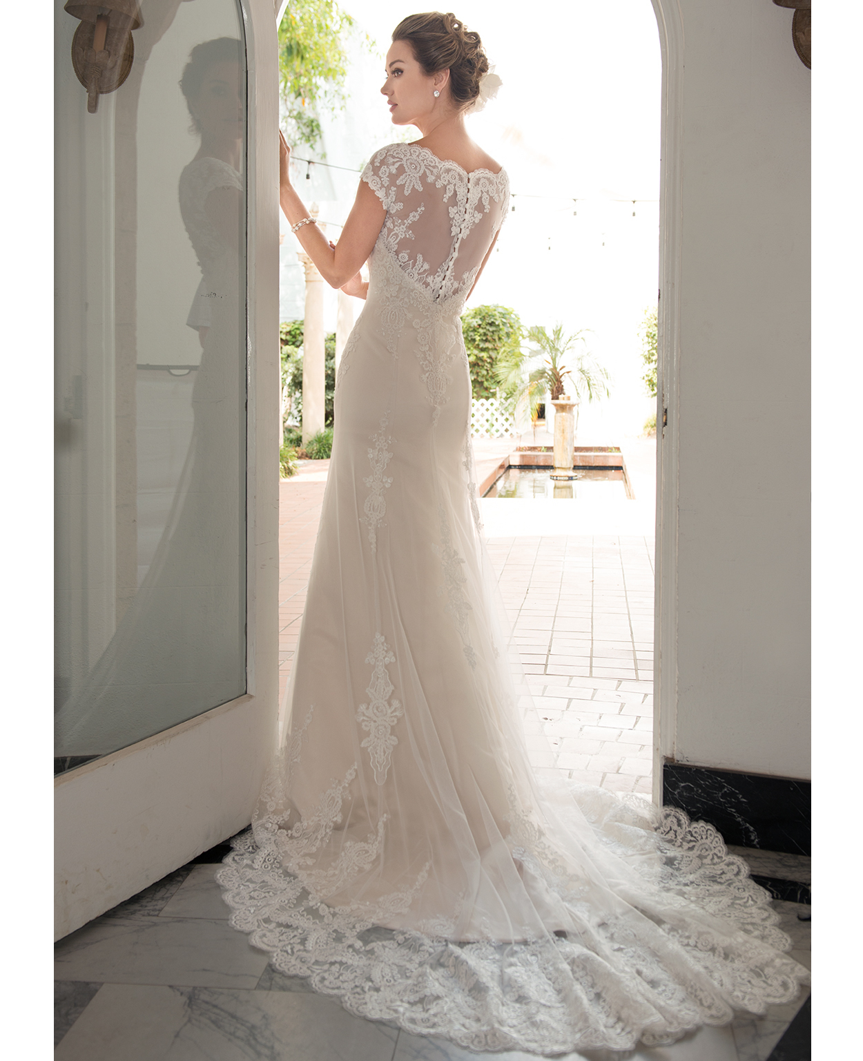 Model wearing an 'A line' style Venus Bridal dress