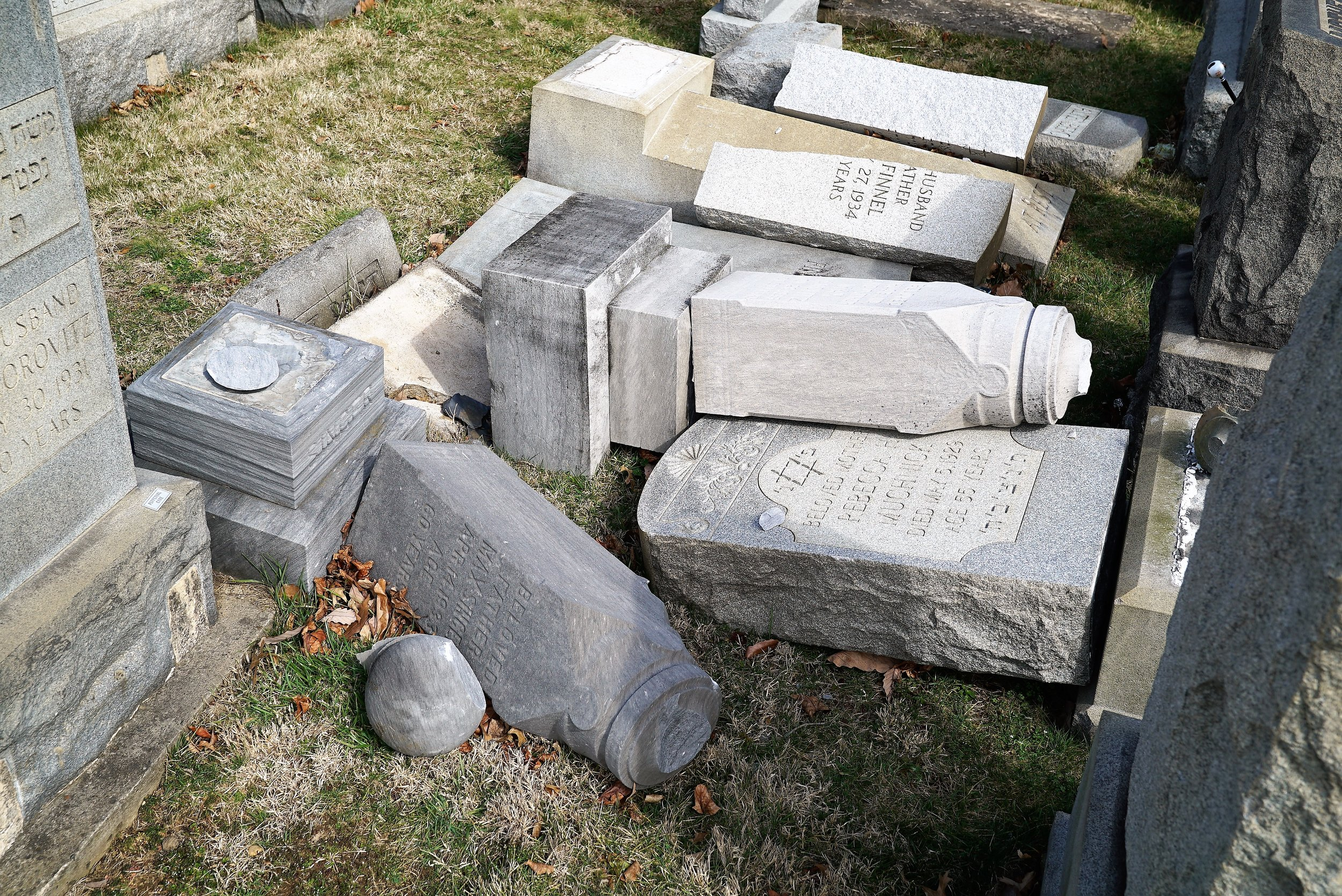 The scene at Mount Carmel Cemetery in Philadelphia, PA after vandals caused extensive damage to the cemetery.