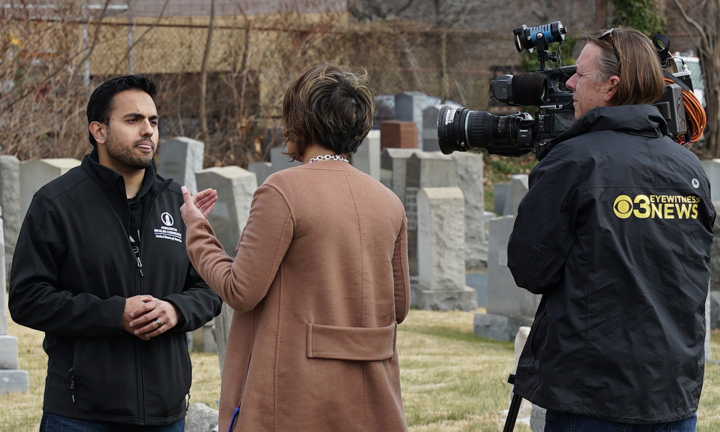A man representing a Muslim cemetery being interviewed at Mount Carmel Jewish Cemetery in Philadelphia, Pennsylvania.