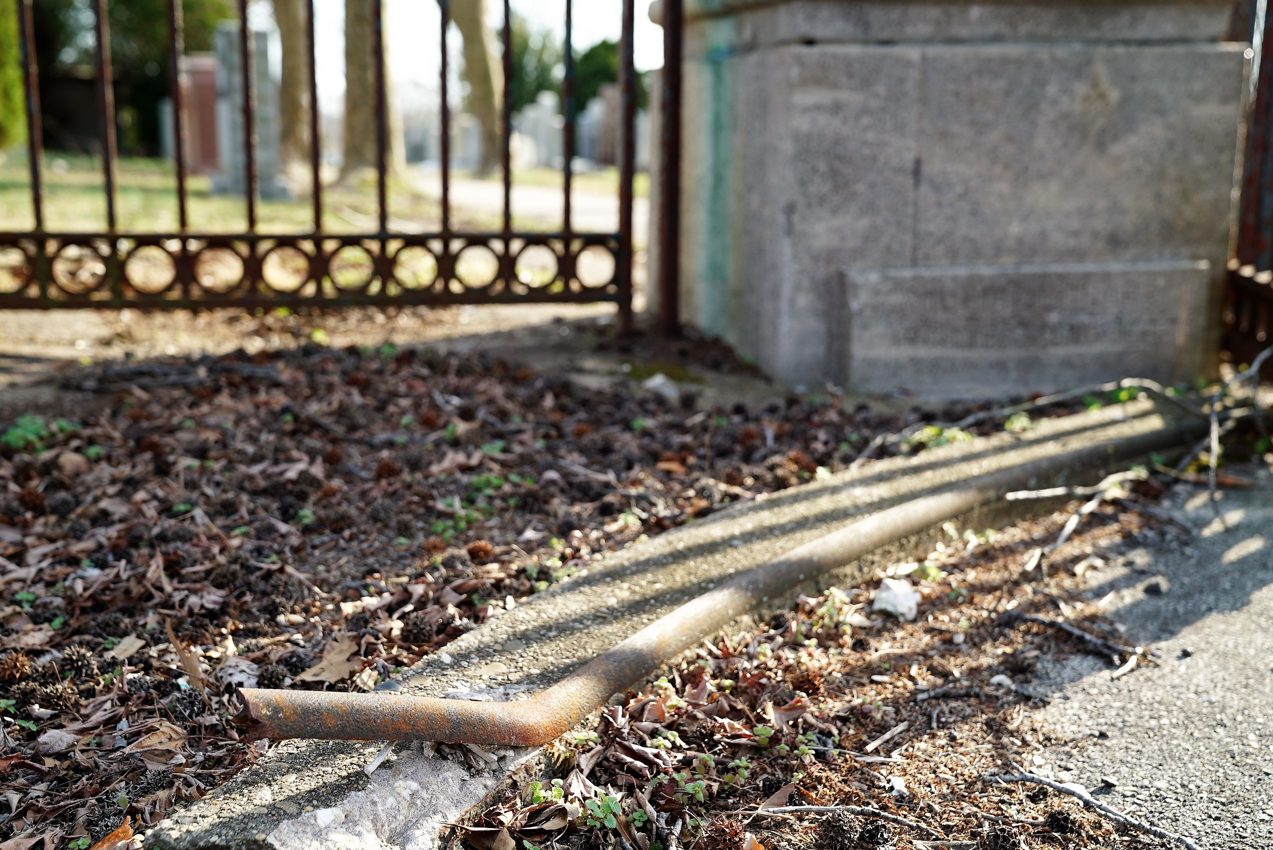 March 6, 2017. A hazardous condition at the entrance to Mount Lebanon Cemetery in Collingdale, Pennsylvania. That is rusty metal that has separated from the curb. I tripped on that.