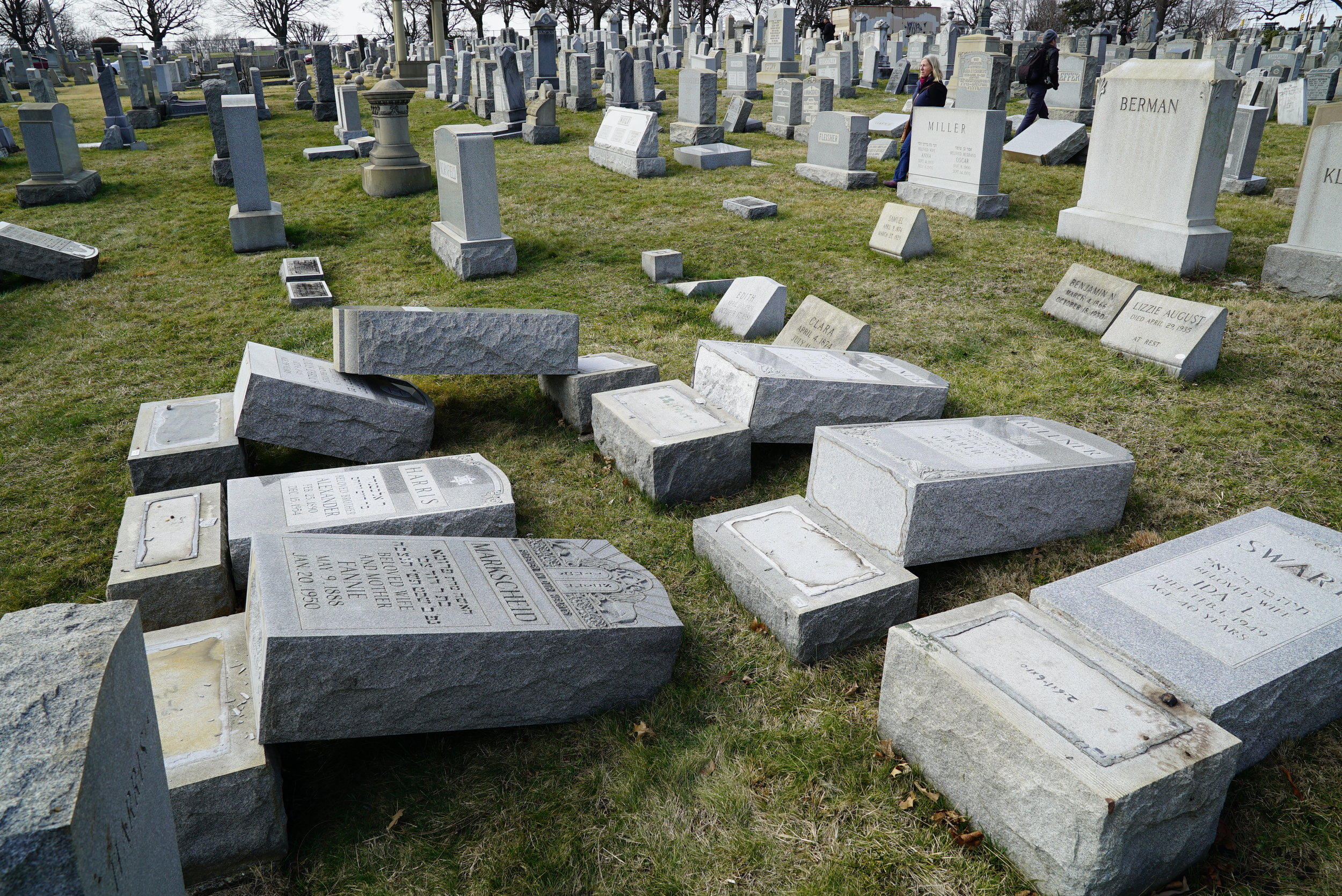 Vandal damage at Mount Carmel Cemetery in Philadelphia. These are thick, extremely heavy stones.