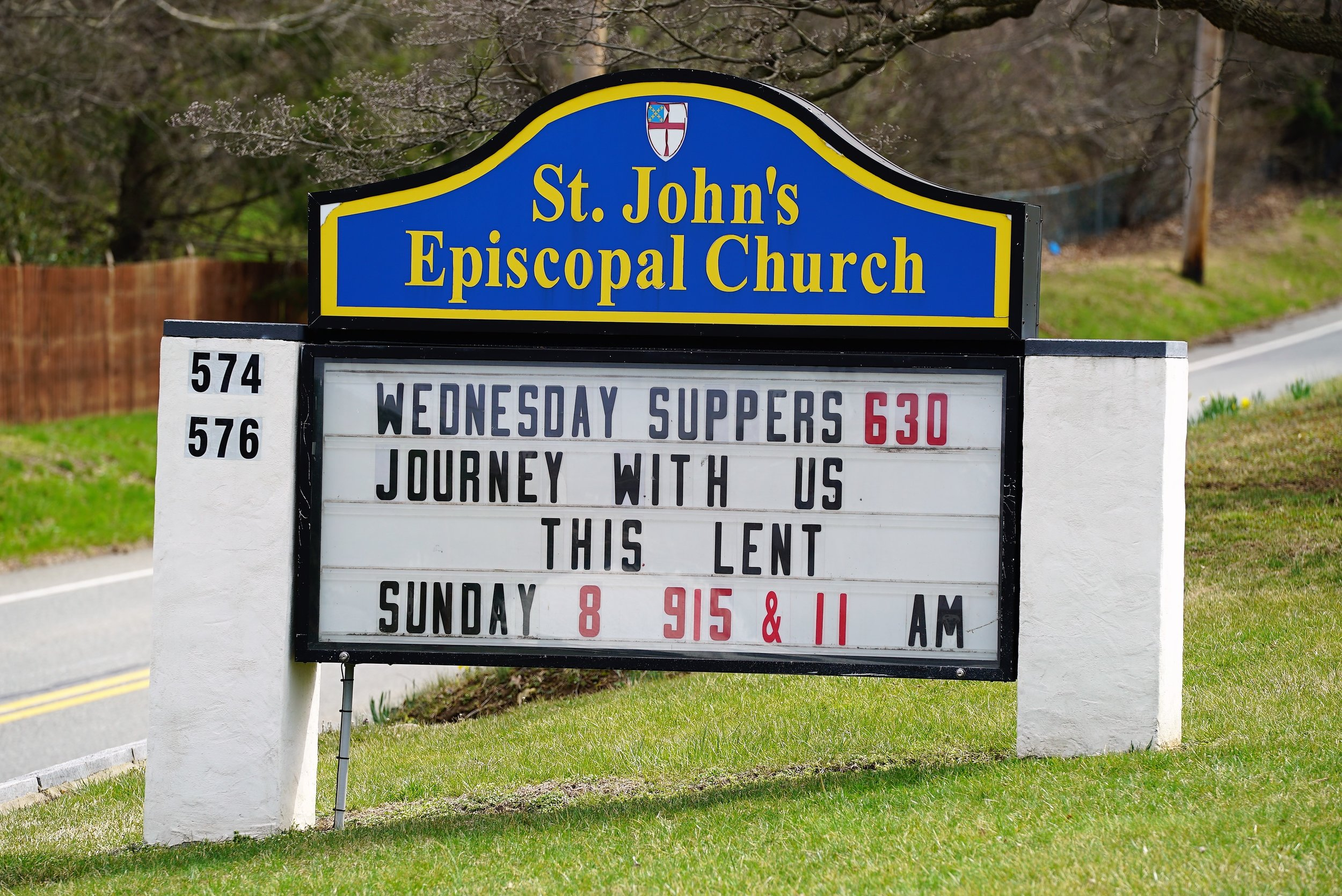 The sign along Concord Road for St. John's Episcopal Church, where a hillside cemetery is located. Glen Mills, Pennsylvania.