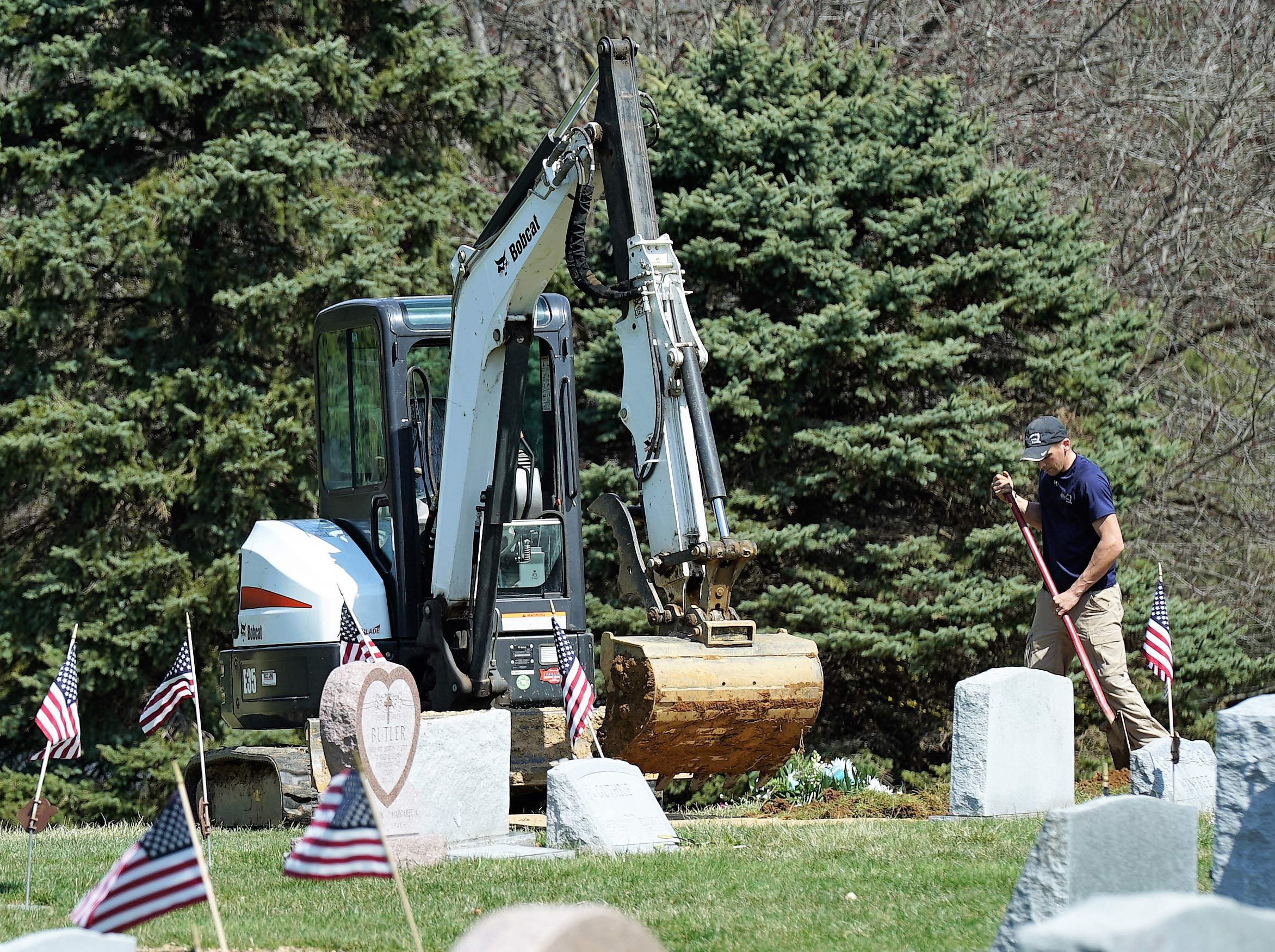 The grave digger at work. Elam United Methodist Church Cemetery. Glen Mills, Pennsylvania.