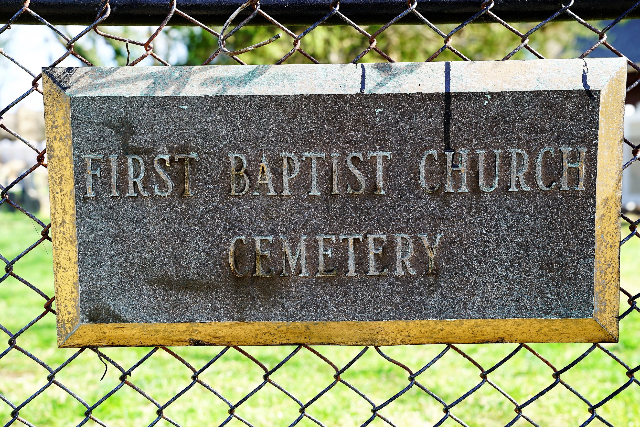 A sign at the sidewalk entrance to First Baptist Church Cemetery. Radnor, Pennsylvania.