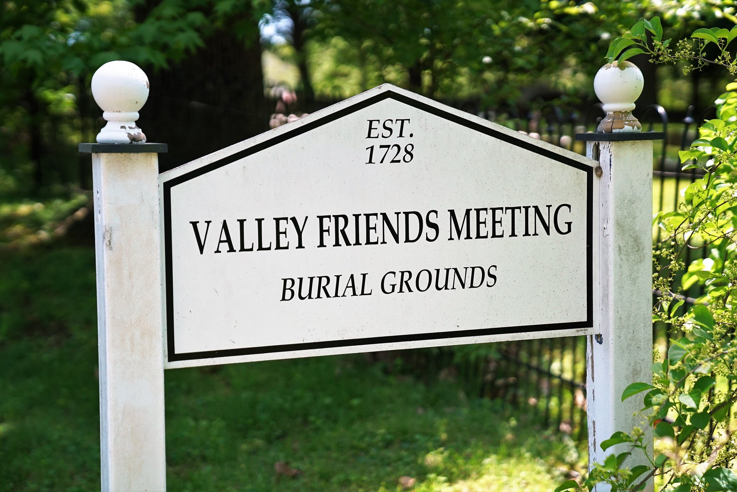 Roadside sign along side Valley Friends Meeting Burial Grounds. Wayne, Pennsylvania.