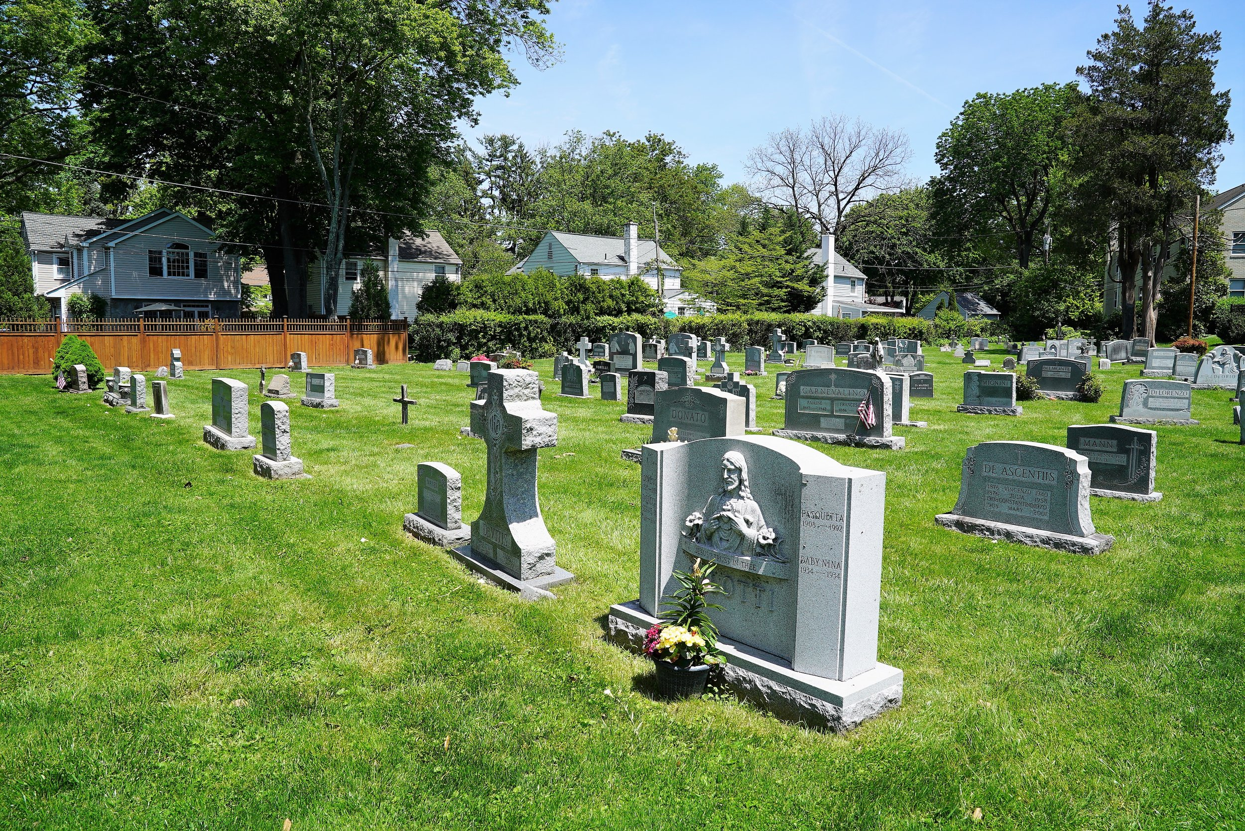 The backyard cemetery at Our Lady Of Assumption Church. Wayne, Pennsylvania.