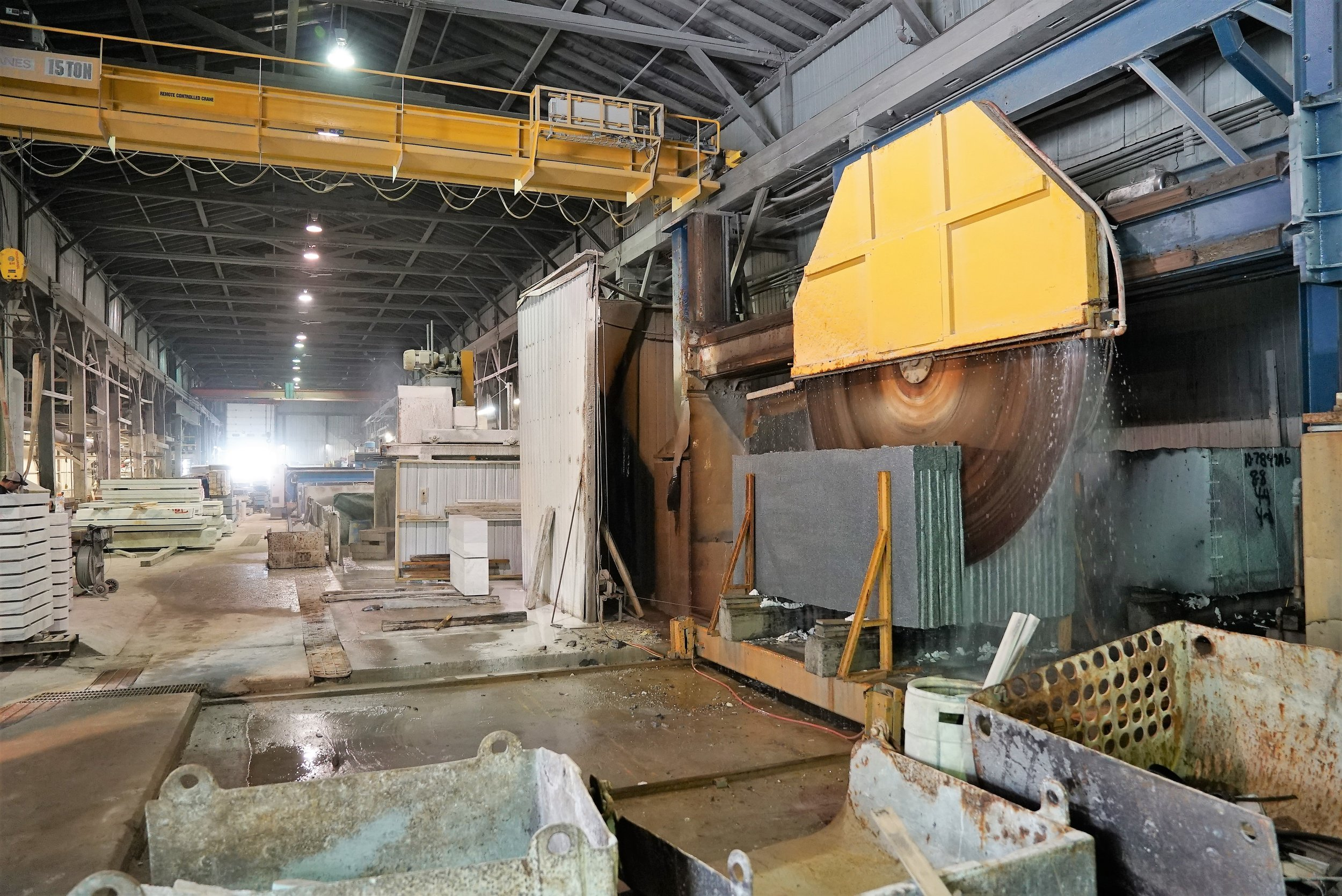 Giant saw cutting a block of granite into more manageable slabs.