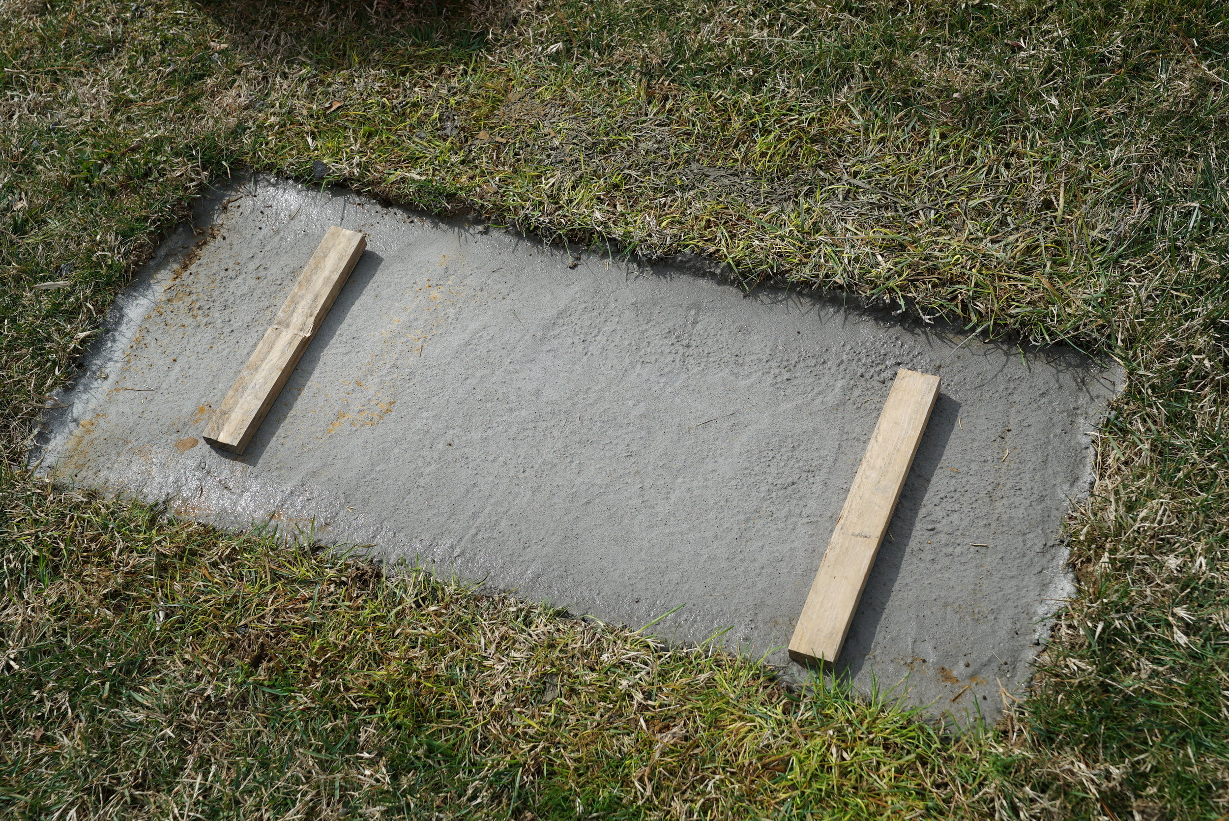 This is what a proper foundation looks like. It is a minimum of 2 feet deep in order to support the stone and prevent leaning of the stone, which can happen over time. The bigger the stone, the deeper the concrete.