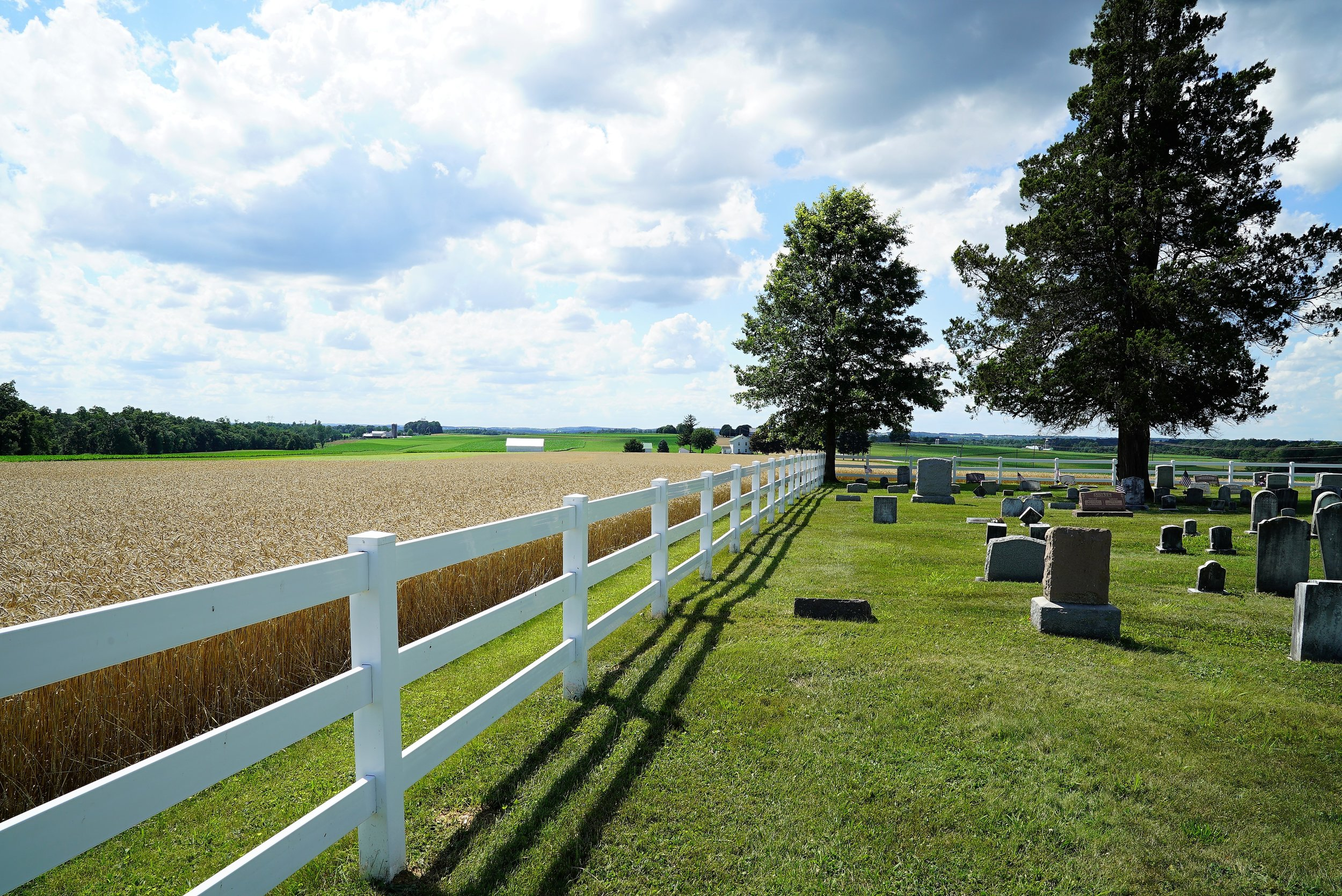 The cemetery at Beulah Baptist Church has vistas of lots of farm land. Oxford, Pennsylvania.