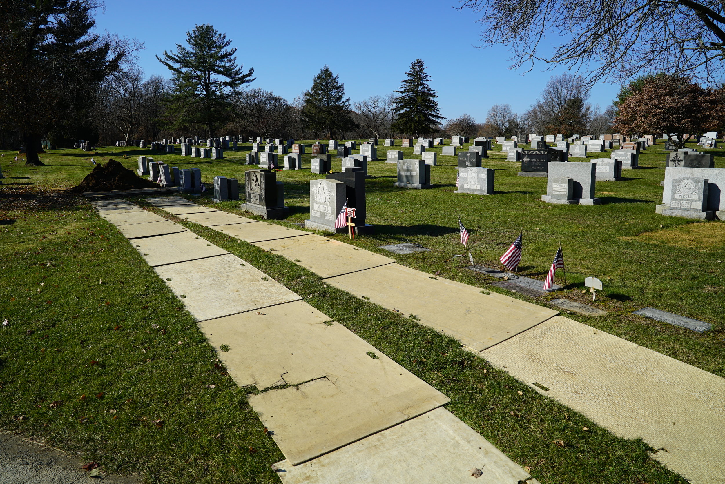 Boards protect the grass when trucks or tactors need access to a grave.