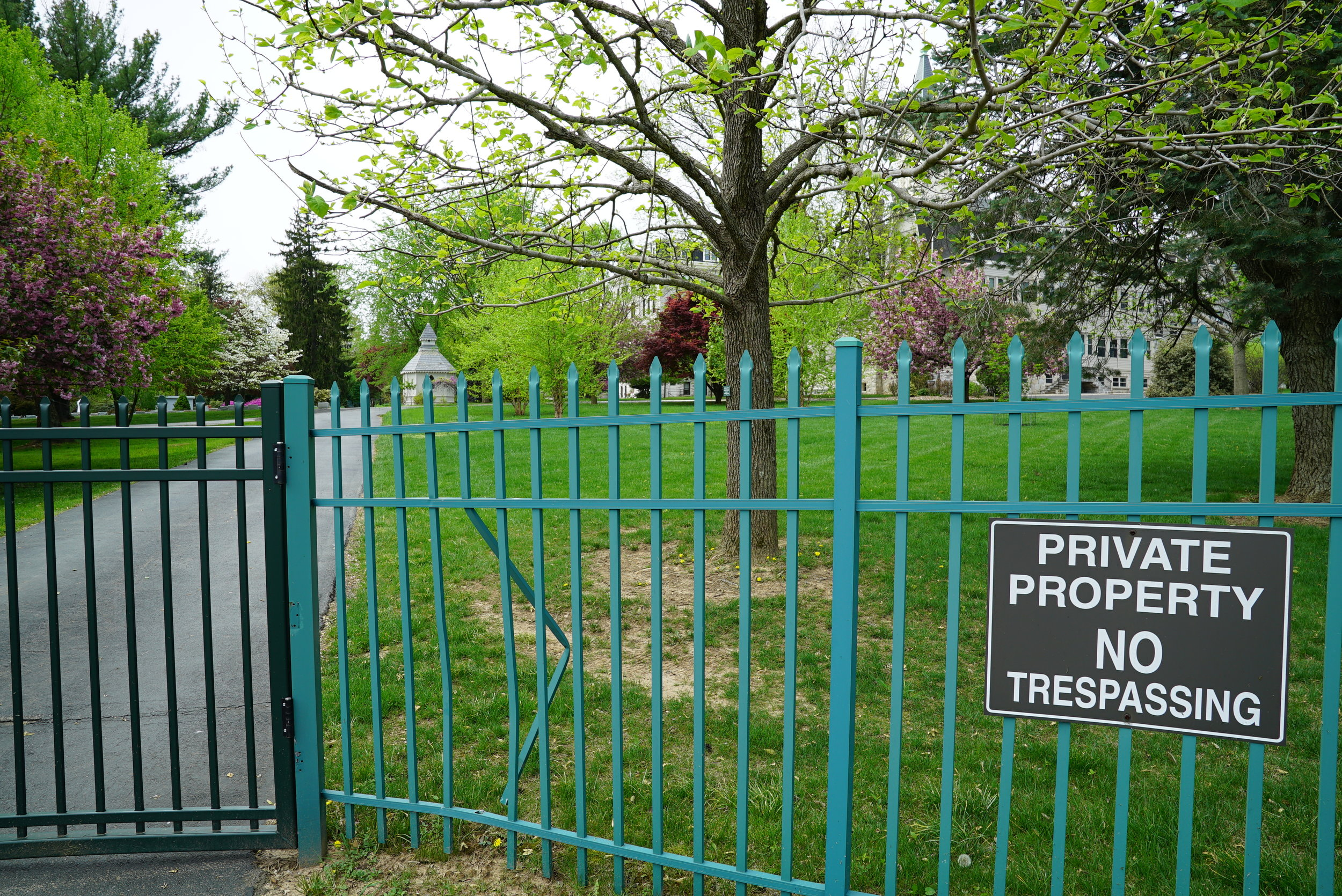 """No Trespassing"" signs are prominently displayed at all entrances to the cemetery. Our Lady of Angels Cemetery. Aston, Pennsylvania."