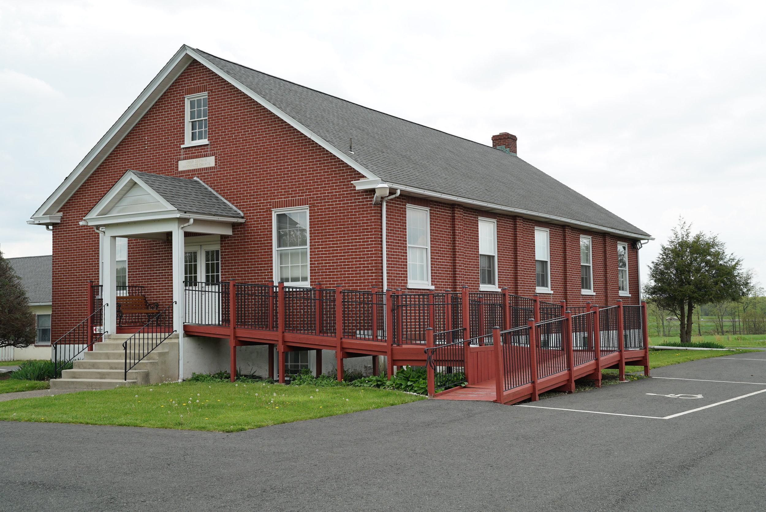 The Wellspring Church building next to Upper Skippack Mennonite Cemetery
