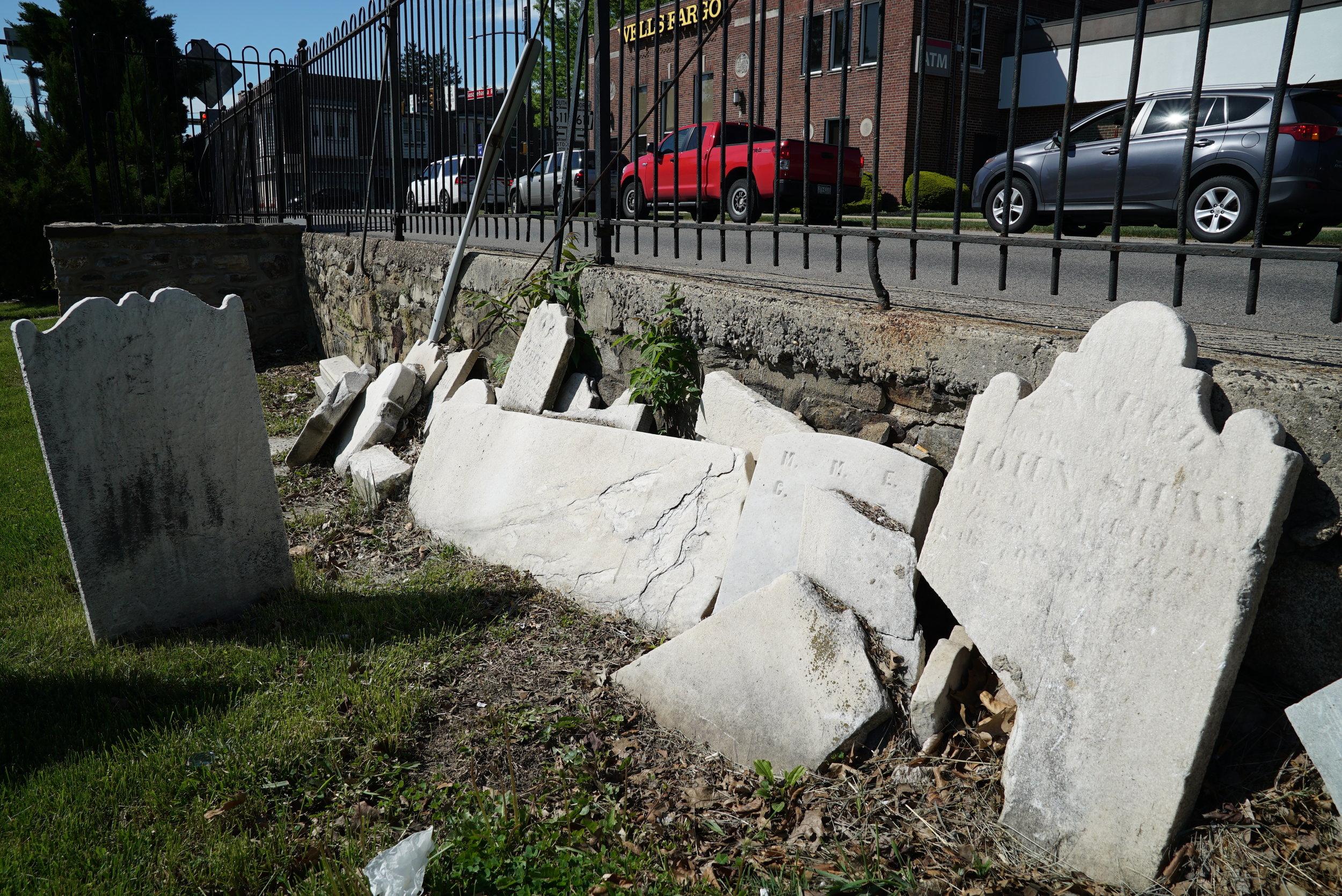 Ancient broken tombstones, set to the side. Abington Presbyterian Church Cemetery. Montgomery County, Pennsylvania.