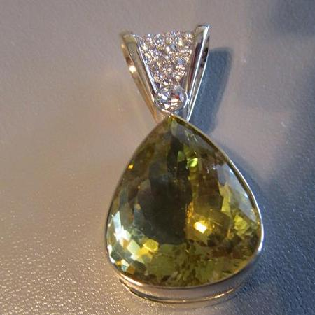18k yellow gold bezel set pendant with a 15 ct. pear-shaped citrine and diamonds