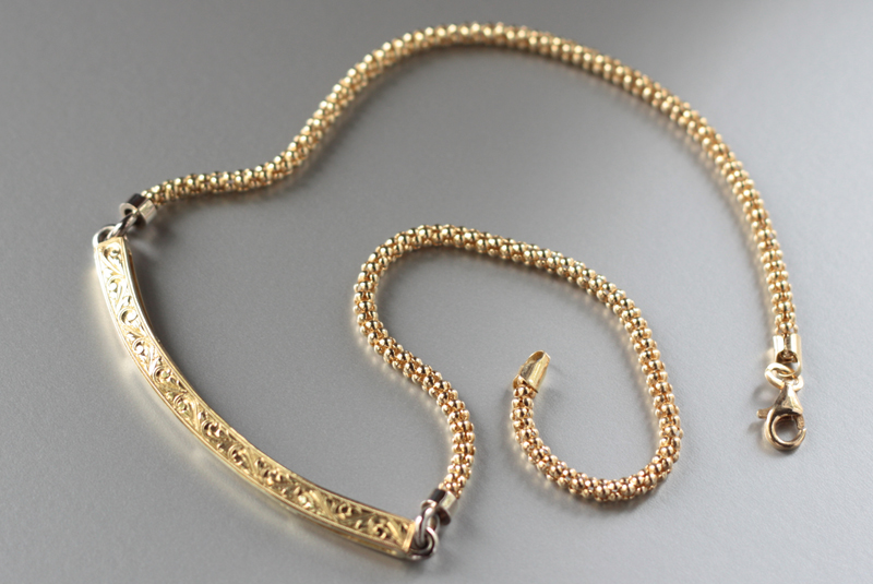 18k handmade, hand-engraved neckpiece. Designed to be customized with dangling charms.