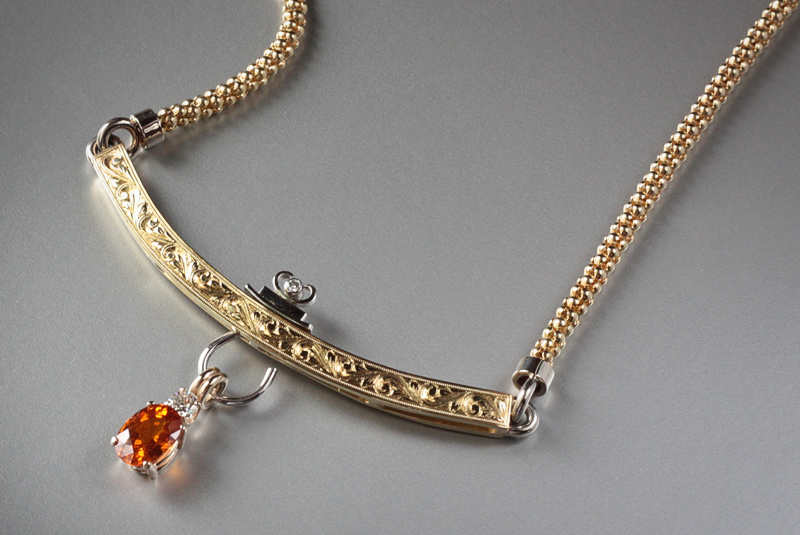 18k handmade, hand-engraved neckpiece with a 2.0 ct. orange sapphire dangling charm